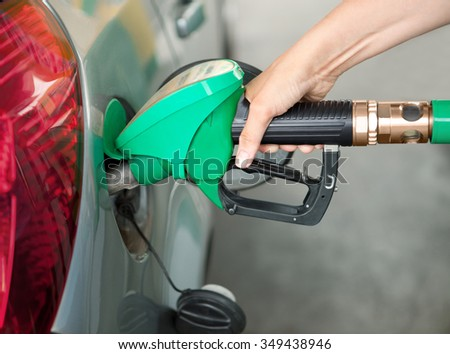 Person Refueling the Car at a Gas Station