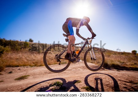 Person riding a mountain bike on a dirt track
