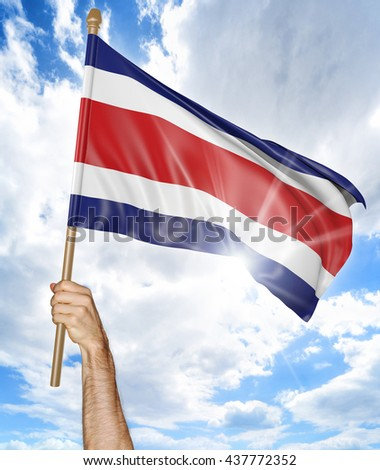 Person's hand holding the Costa Rican national flag and waving it in the sky, part 3D rendering - stock photo