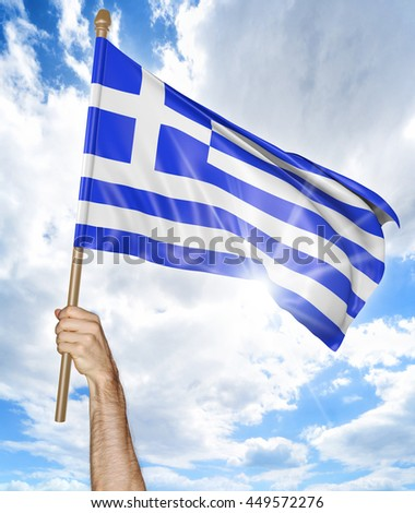 Person's hand holding the Greek national flag and waving it in the sky, 3D rendering - stock photo