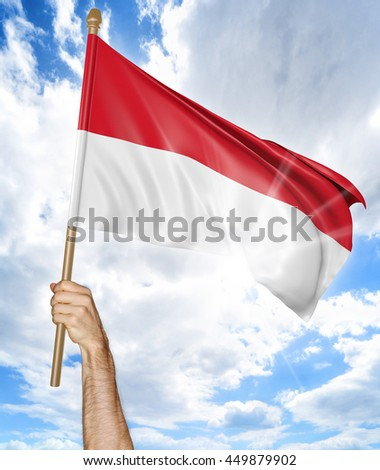 Person's hand holding the Indonesian national flag and waving it in the sky, 3D rendering - stock photo