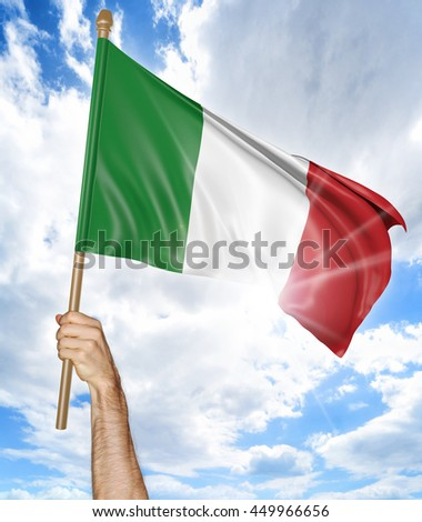 Person's hand holding the Italian national flag and waving it in the sky, 3D rendering - stock photo