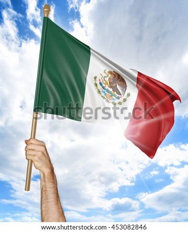 Person's hand holding the Mexican national flag and waving it in the sky, 3D rendering - stock photo