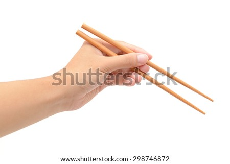 Person 's left hand using bamboo chopsticks against white background