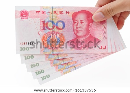 Person's right hand giving out Renminbi (RMB) against white background - stock photo