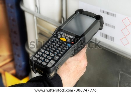 Person scanning a bar code with a handheld electronic scanner to identify a retail product or inventory and access the price and information on a digital readout - stock photo