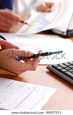 Person signing important document isolated - stock photo