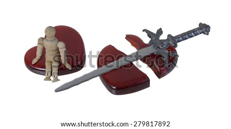 Person Sitting on a Shattered Heart with a Sword - path included - stock photo