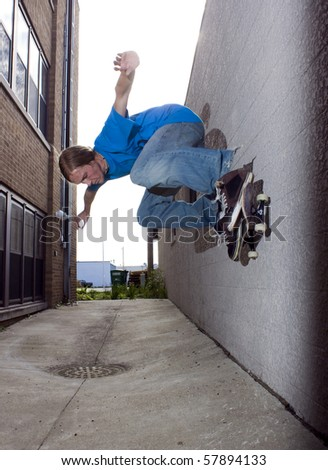 person skateboarding, doing a trick - stock photo