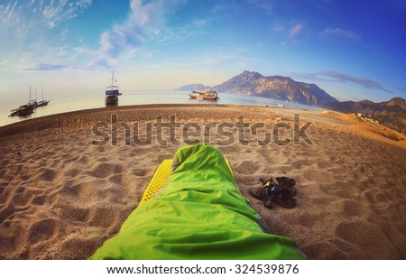 Person sleeping on beach,Cirali Turkey