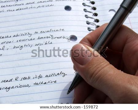 Person takes notes - stock photo