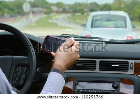 Person texting while driving vehicle