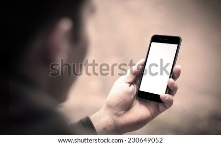 Person using mobile smartphone, iphon 6 style. Shot with third-person view. - stock photo