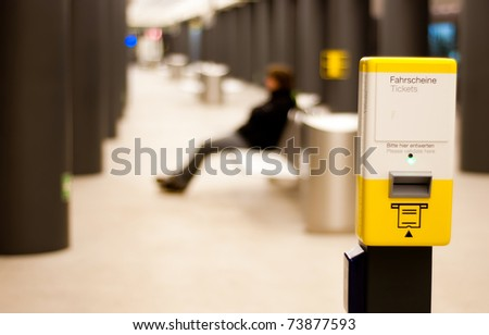 Person waiting at the station for the train - stock photo