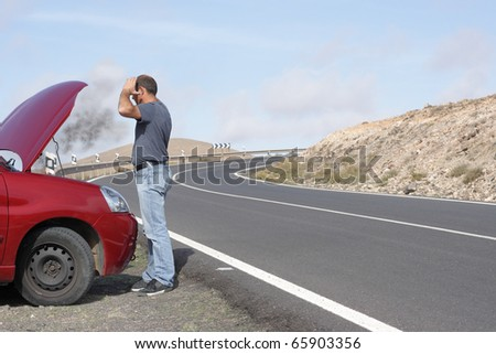 person with car breakdown and engine trouble - stock photo