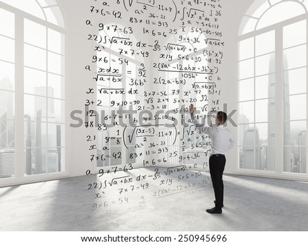 Person write math formula in an empty space - stock photo