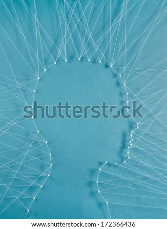 Personal communication. The head of a man connected to exterior by threads - stock photo