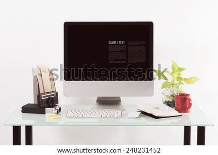 personal computer on desktop with blank screen - stock photo
