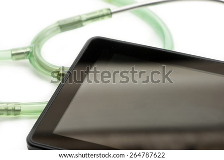 Personal computing device with stethoscope tubing on white background.