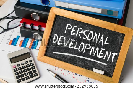 personal development concept handwritten on blackboard - stock photo