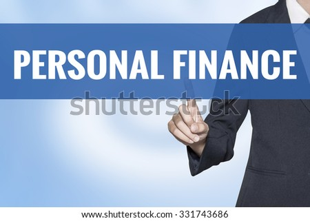 Personal Finance word on virtual screen touch by business woman blue background - stock photo