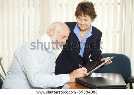 Personal injury lawyer signs up a new injured client. - stock photo