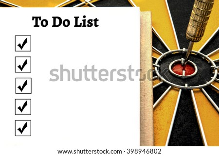 Personal notebook with a to do list and dart target arrow on the center of dartboard, To do list and smart goal target success business investment financial strategy concept, abstract background - stock photo
