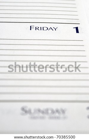 Personal planner opened to Friday the 1st. - stock photo