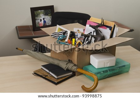 personal property in carton on office desk - stock photo
