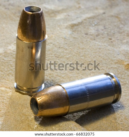 personal protection bullets for a 9 mm handgun - stock photo