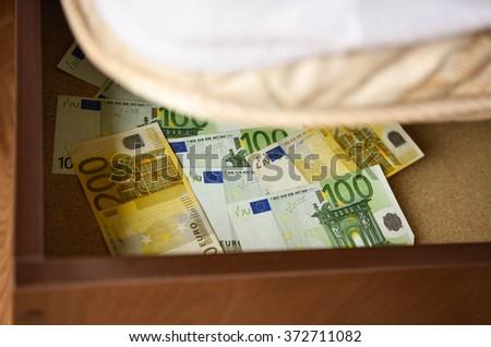 Personal savings deposited under the mattress - stock photo