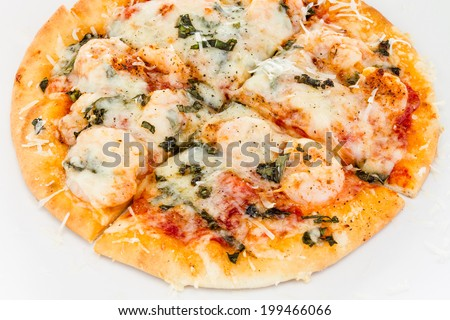 Personal sized sliced shrimp, basil and cheese pizza. - stock photo