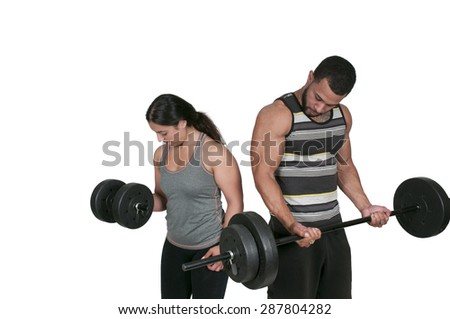 Personal trainer coaching a client as they exercise