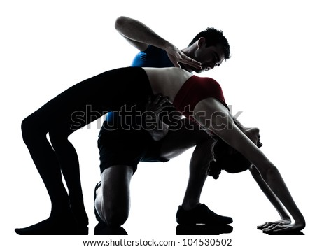 personal trainer man coach and woman exercising yoga bridge position gymnastic silhouette  studio isolated on white background - stock photo
