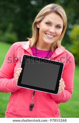 Personal trainer showing blank tablet PC