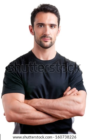 Personal trainer with is arms crossed, isolated in white - stock photo