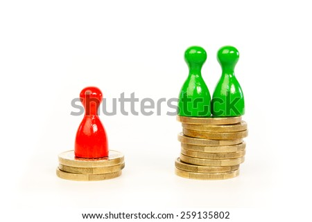 Persons with differences in income shown in stacks of coins and pawns - stock photo