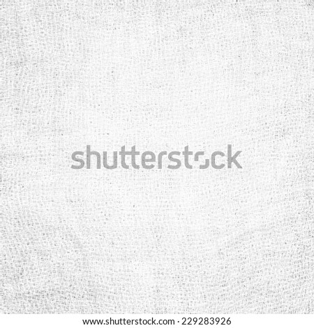 Perspective and closeup view to abstract canvas of empty light gray and white natural clean gauze texture for the traditional business background with sparse threads and clear space for your own text. - stock photo