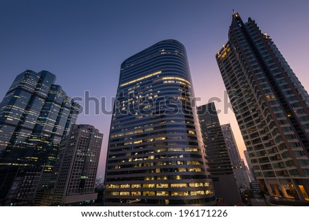 Perspective and underside angle view of Modern skyscrapers at dusk. - stock photo