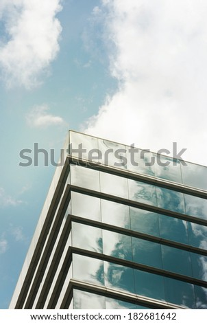 Perspective and underside angle view to textured background of modern glass building