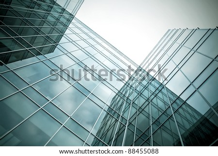 perspective angle view to high rise glass skyscrapers - stock photo