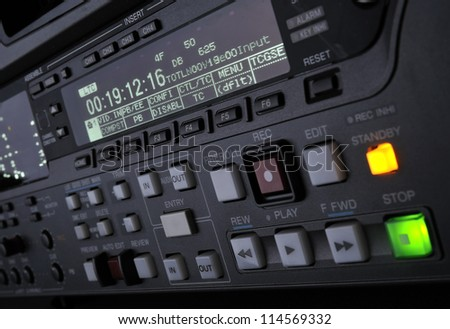 Perspective close-up of the front panel of the professional digital betacam video recorder.  Shallow dof. Displays, equalizer, buttons. - stock photo