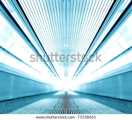 perspective escalator inside contemporary airport - stock photo