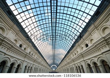 Perspective Glass roof skylight of long building Metalic glass roof of long building - stock photo