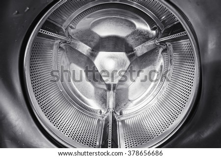 perspective inside view into washing machine drum - stock photo