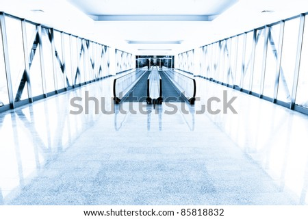 Perspective of blue modern interior in office building - stock photo