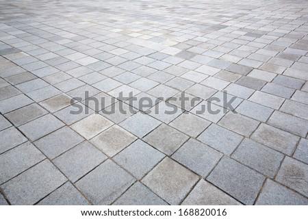 Perspective of concrete brick pavement road - stock photo