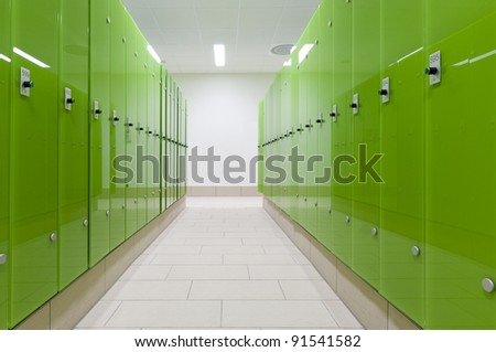 Perspective of green safe deposit box in a swimming bath or pool - stock photo