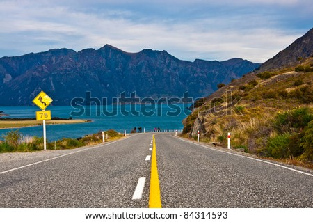 perspective of highway road freeway to lake Hawea in Wanaka New Zealand - stock photo