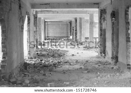 Perspective of long corridor. Black and white image - stock photo